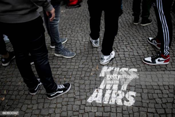New KAWS x Air Jordan IV sneakers buyers wait outside the Overkill sneakers store on March 29 2017 in Berlin Germany to check them selves Several...