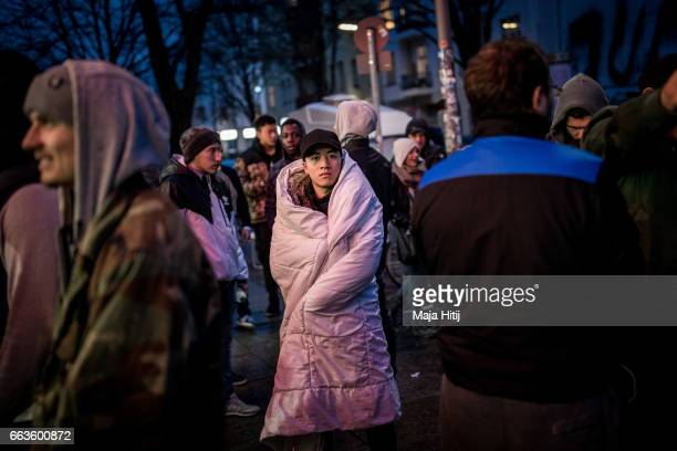 New KAWS x Air Jordan IV sneakers buyers wrapped in a blanket stands outside the Overkill sneakers store on March 29 2017 in Berlin Germany Several...