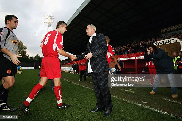 New Kettering manager Paul Gascoigne shakes hands with Craig McIlwain after they win during the Nationwide Conference North match between Kettering...