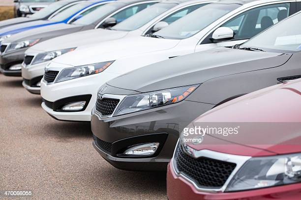 new kia optima vehicles in a row - kia stock pictures, royalty-free photos & images