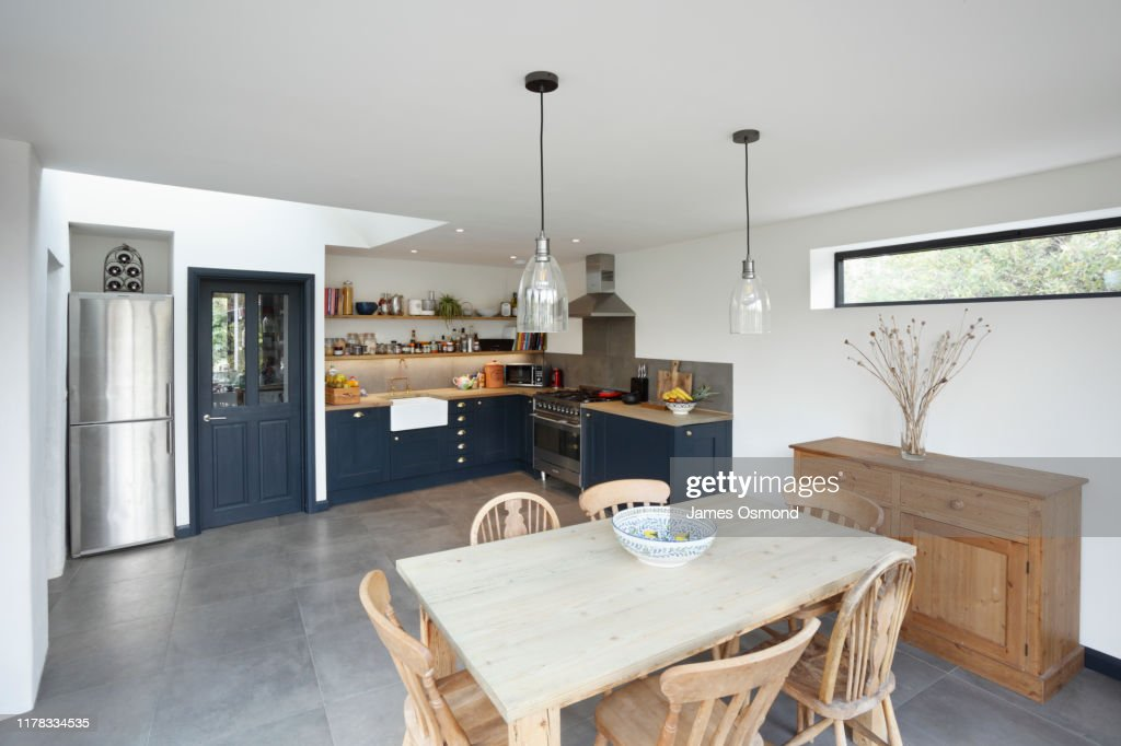 New kitchen and diner extension interior. Built onto the side of a listed historic building. : Stock Photo