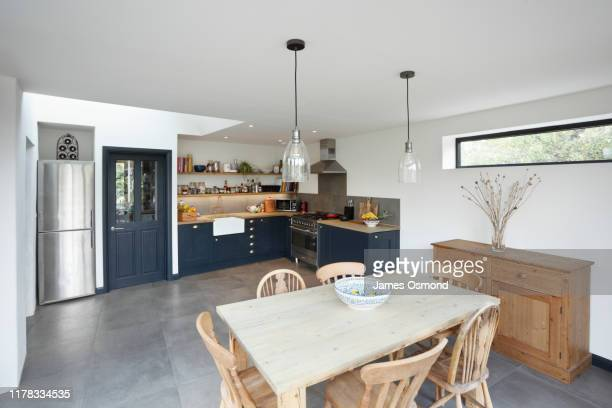 new kitchen and diner extension interior. built onto the side of a listed historic building. - furniture stock pictures, royalty-free photos & images