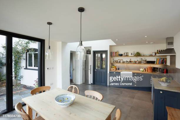 new kitchen and diner extension interior. built onto the side of a listed historic building. - uk stock pictures, royalty-free photos & images