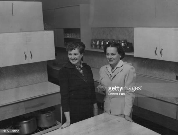 New kitchen facilities at the Florence Crittenton home are examined by Mrs Rex B West president of the board of trustees and Mrs Dayton Denious An...