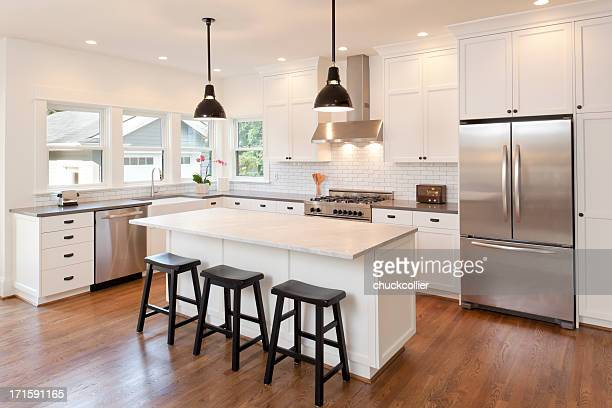 new kitchen in modern luxury home - lighting equipment stock pictures, royalty-free photos & images