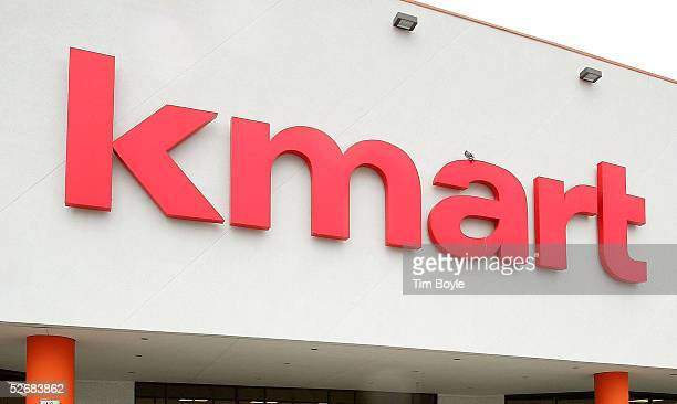A new Kmart sign hangs on a newly revamped Kmart store April 22 2005 in Norridge Illinois The store is one of nine test stores where some Searsbrand...