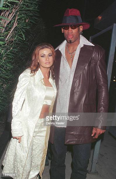 New Laker Dennis Rodman celebrates his first winning game out on the town at GOODBAR with wife Carmen Electra in Beverly Hills CA February 26 1999