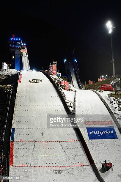 A new laser system displaying the distance to beat to spectators is seen on day 1 of the Four Hills Tournament Ski Jumping event at...
