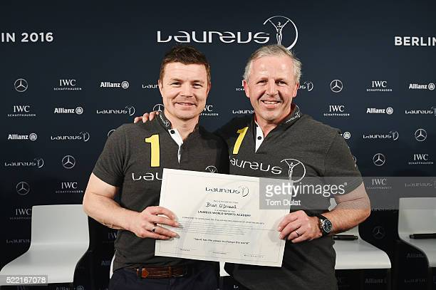 New Laureus World Sports Academy member Brian O'Driscoll poses with Laureus World Sports Academy member Sean Fitzpatrick during a Rugby Press...