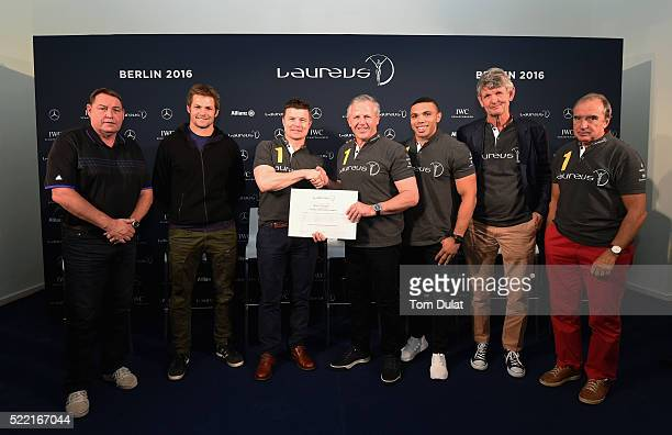 New Laureus World Sports Academy member Brian O'Driscoll shakes the hand of Laureus World Sports Academy member Sean Fitzpatrick as Steve Hansen All...