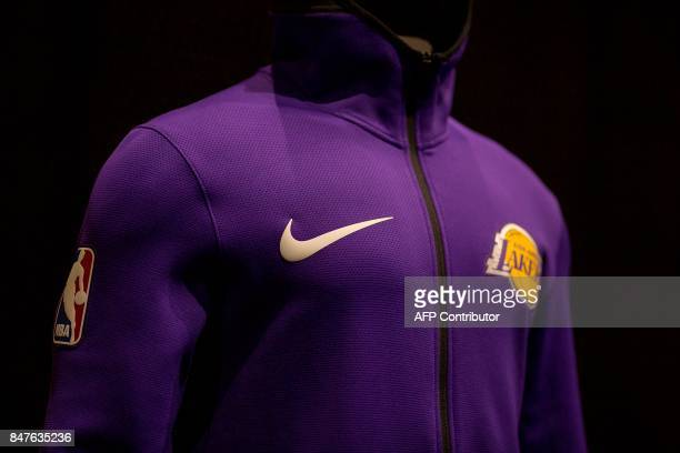 New league uniforms representing a new partnership between Nike and the NBA are displayed on September 15, 2017 in Los Angeles, California. / AFP...