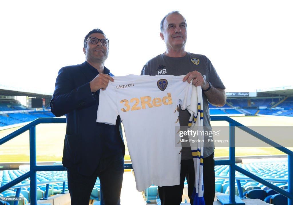 New Leeds United manager Marcelo Bielsa stands with owner Andrea Radrizzani (l) during the press conference at Elland Road, Leeds.