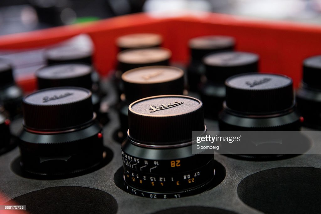 New Leica Summilux-M 28 mm f/1.4 Aspherical lenses sit on the assembly line at the Leica Camera AG factory in Wetzlar, Germany, on Tuesday, Nov. 28, 2017. German factory orders unexpectedly rose for a third month in October, in a sign that Europes largest economy will carry its strong momentum into 2018. Photographer: Krisztian Bocsi/Bloomberg via Getty Images