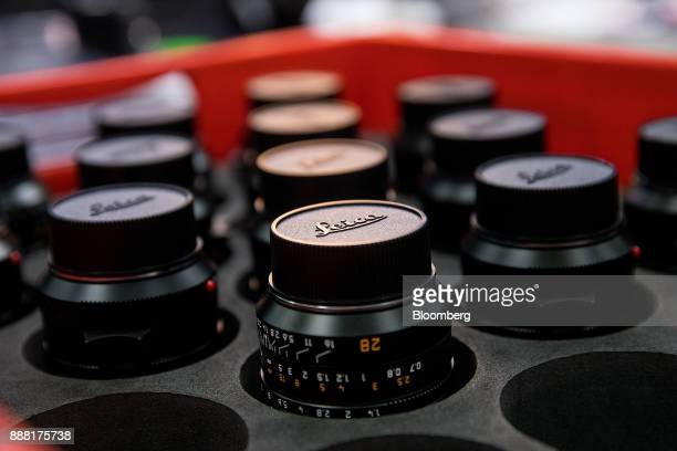 New Leica SummiluxM 28 mm f/14 Aspherical lenses sit on the assembly line at the Leica Camera AG factory in Wetzlar Germany on Tuesday Nov 28 2017...