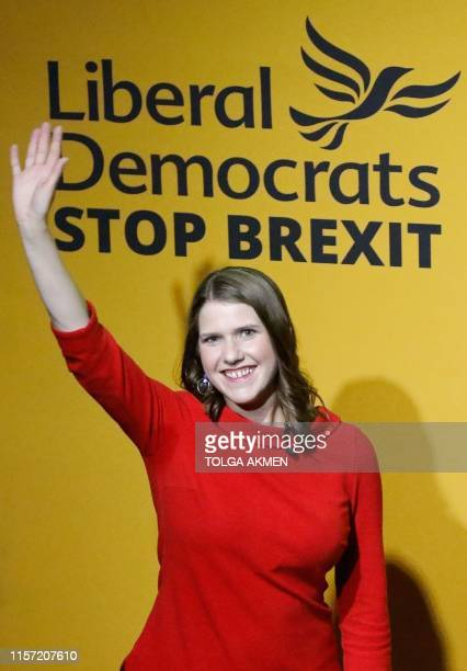 New Liberal Democrat leader Jo Swinson waves on stage at an event annoucing the result of the leadership contest in central London on July 22 2019 Jo...