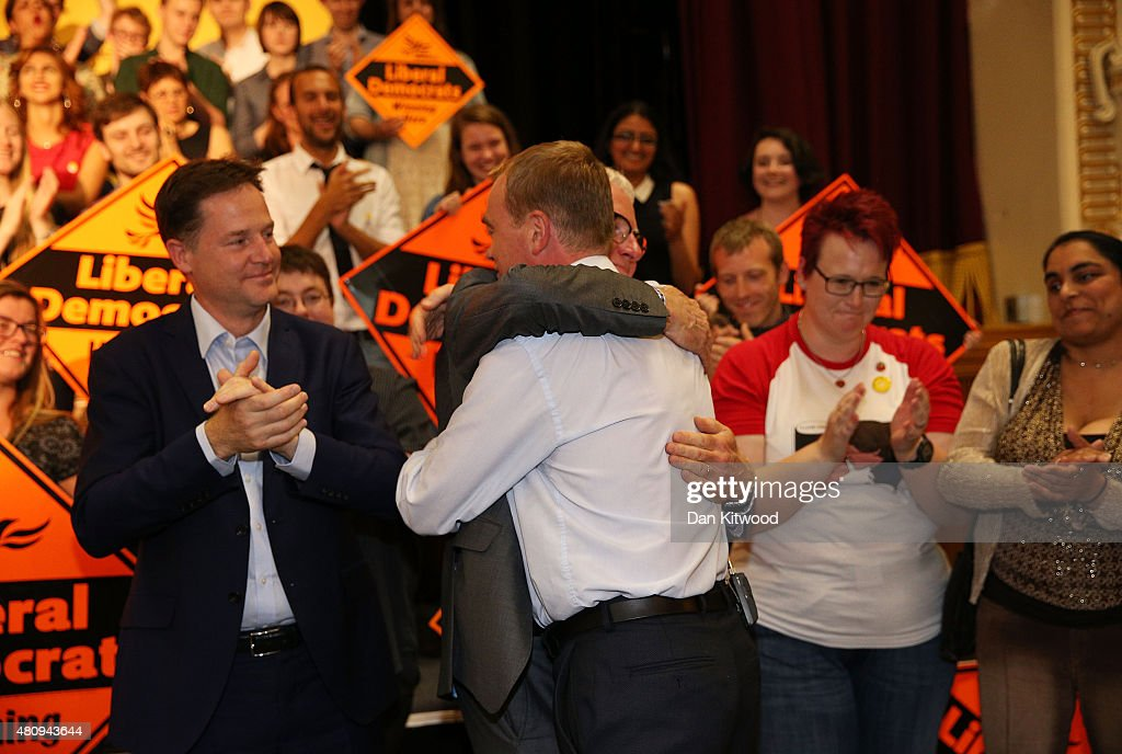New Liberal Democrat Party Leader Tim Farron hugs contender Norman Lamb as former leader of the party Nick Clegg applauds (L) at Islington Assembly Hall on July 16, 2015 in London, England. Tim Farron, MP for Westmorland and Lonsdale, who was the former party president, will replace Nick Clegg after winning 56.5% of the votes.