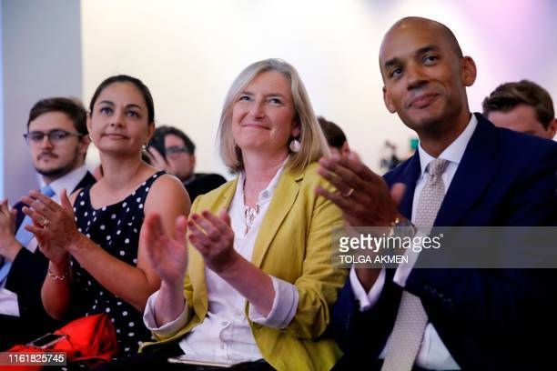 New Liberal Democrat Sarah Wollaston a former Conservative sits next to Liberal Democrat MP Chuka Umunna a former Labour MP at an event where party...