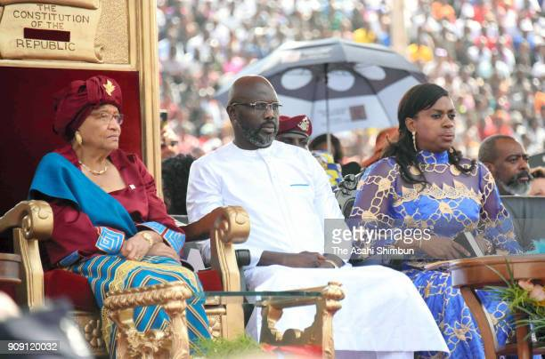 New Liberian President George Weah attends the inarguration ceremony with outgoing president Ellen Johnson Sirleaf and his wife Clar Weah on January...
