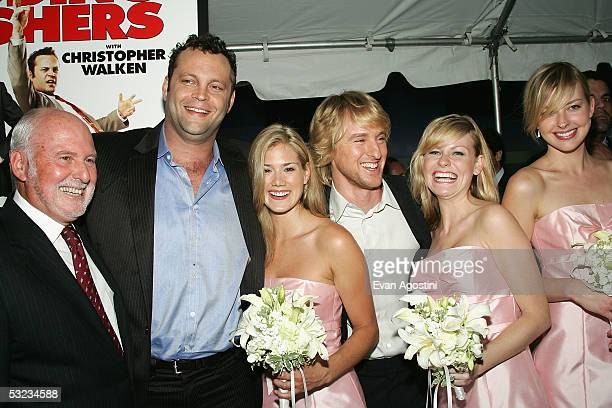 """New Line Cinema Co-CEO Michael Lynne, actors Vince Vaughn and Owen Wilson pose with """"bridesmaids"""" Heidi Bailey and Amelia Nelson at the premiere of..."""