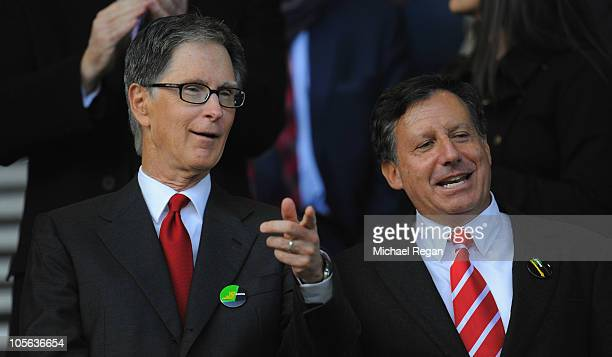 New Liverpool co-owners John W Henry and NESV Chairman Tom Werner look on during the Barclays Premier League match between Everton and Liverpool at...