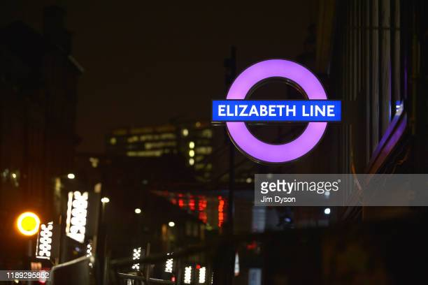 A new London Underground roundel for the Elizabeth Line is illuminated outside the new Crossrail station at Farringdon on November 21 2019 in London...
