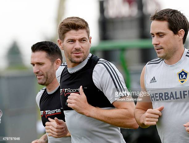 New Los Angeles Galaxy midfielder Steven Gerrard jogs with his teammates during a training session on July 7, 2015 at StubHub Center in Carson,...
