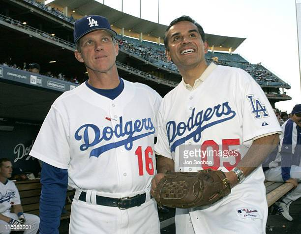 New Los Angeles Mayor Antonio Villaraigosa poses with Los Angeles Dodgers manager Jim Tracy prior to throwing out the first pitch before the Los...