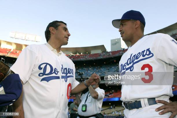 New Los Angeles Mayor Antonio Villaraigosa visits with Los Angeles Dodgers shortstop Cesar Izturis prior to throwing out the first pitch before the...