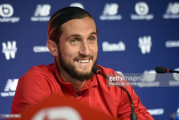 New Losc midfielder Yusuf Yazici speaks during a press conference on August 7 at the Domaine de Luchin in Camphin en Pevele north of France Lille...