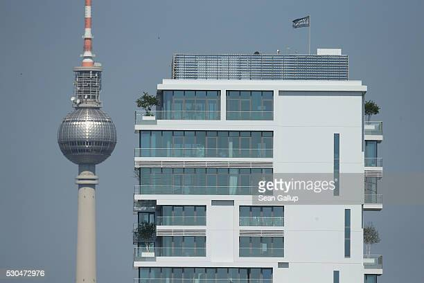 A new luxury apartment building stands near the broadcast tower at Alexanderplatz in Mitte district in the city center on May 11 2016 in Berlin...
