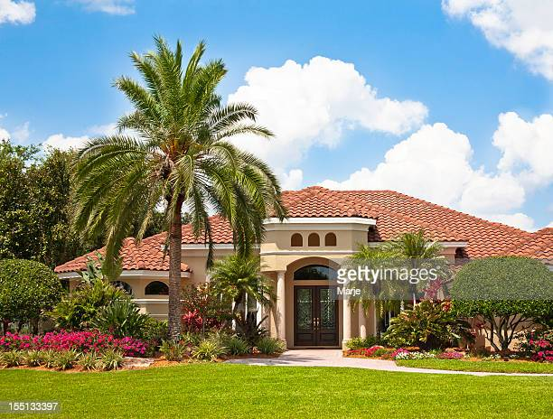 new luxury home with tropical garden - southern usa stock pictures, royalty-free photos & images