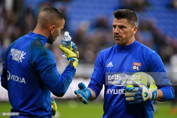 New Lyon's French goalkeeper's coach Gregory Coupet takes part in a training session with Lyon's Portuguese goalkeeper Anthony Lopes before the...
