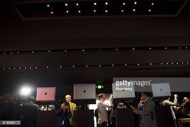 New MacBook Pro laptop computers are displayed during an event at Apple Inc headquarters in Cupertino California US on Thursday Oct 27 2016 Apple Inc...