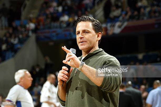 New majority owner Dan Gilbert of the Cleveland Cavaliers talks to the fans during a timeout in the game against the Seattle SuperSonics on March 2...