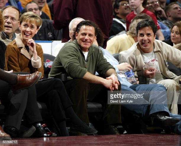 New majority owner Dan Gilbert of the Cleveland Cavaliers watches his team play against the Seattle SuperSonics on March 2, 2005 at Gund Arena in...
