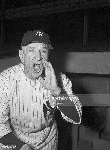 New manager Casey Stengel of the New York Yankees stands on the dugout steps at the Yankee Stadium February 17 and tries out his voice as he gets...