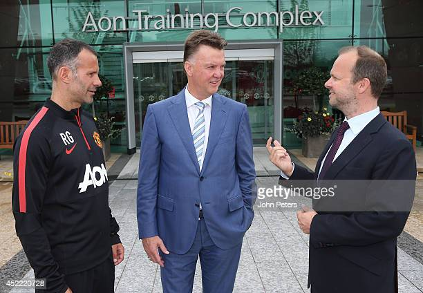 New manager Louis van Gaal of Manchester United poses with assistant manager Ryan Giggs and Executive Vice Chairman Ed Woodward as he starts his new...