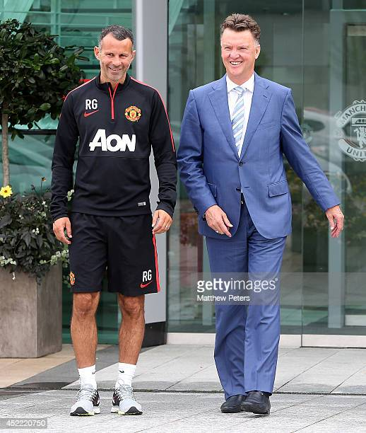 New manager Louis van Gaal of Manchester United poses with assistant manager Ryan Giggs as he starts his new role at Aon Training Complex on July 16,...