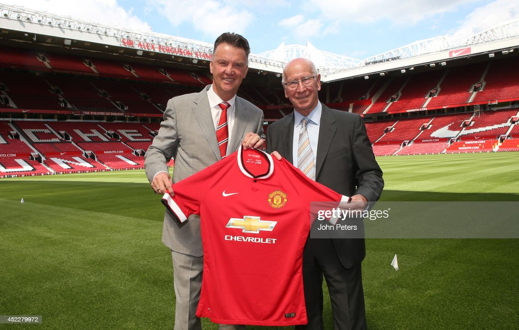 New manager Louis van Gaal (L) of Manchester United poses with club legend Sir Bobby Charlton after a press conference to announce his arrival at Old Trafford on July 17, 2014 in Manchester, England.
