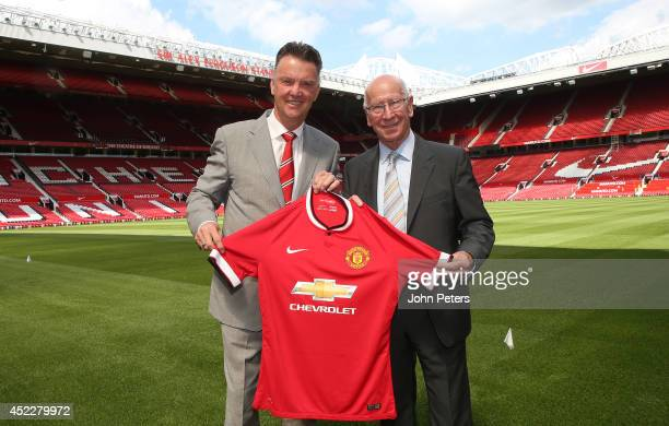 New manager Louis van Gaal of Manchester United poses with club legend Sir Bobby Charlton after a press conference to announce his arrival at Old...