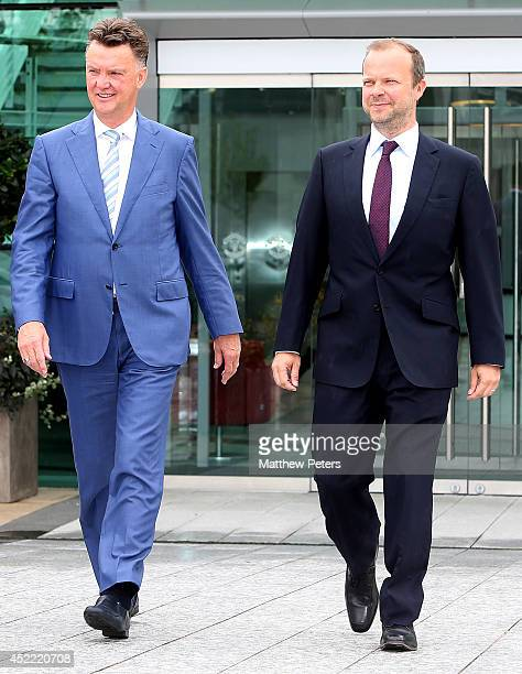 New manager Louis van Gaal of Manchester United poses with Executive Vice Chairman Ed Woodward as he starts his new role at Aon Training Complex on...