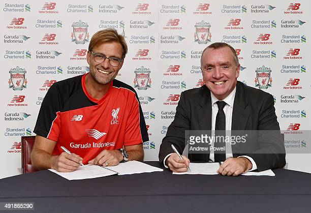New Manager of Liverpool Jurgen Klopp signs his new contract to manage Liverpool with Ian Ayre chief executive officer of Liverpool Football on...