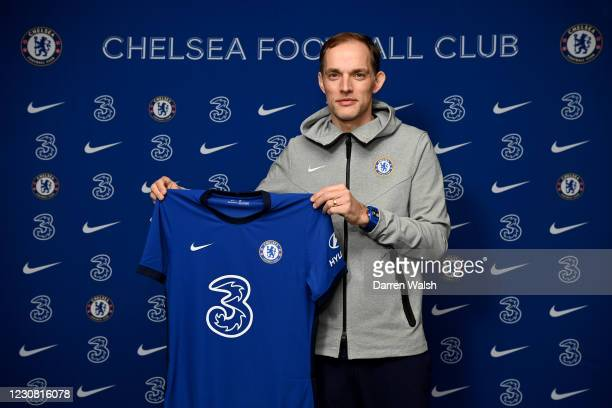 New manager Thomas Tuchel of Chelsea holds up the home Nike Shirt at Stamford Bridge on January 27, 2021 in London, England.