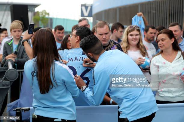 New Manchester City signing Riyad Mahrez greets and signs autographs for fans at the Etihad Stadium Manchester