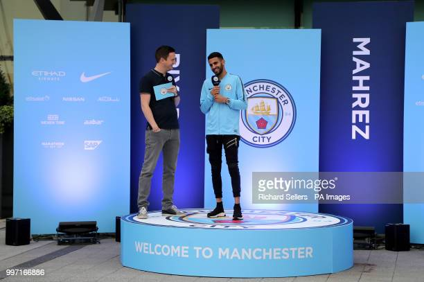 New Manchester City signing Riyad Mahrez greets fans at the Etihad Stadium Manchester