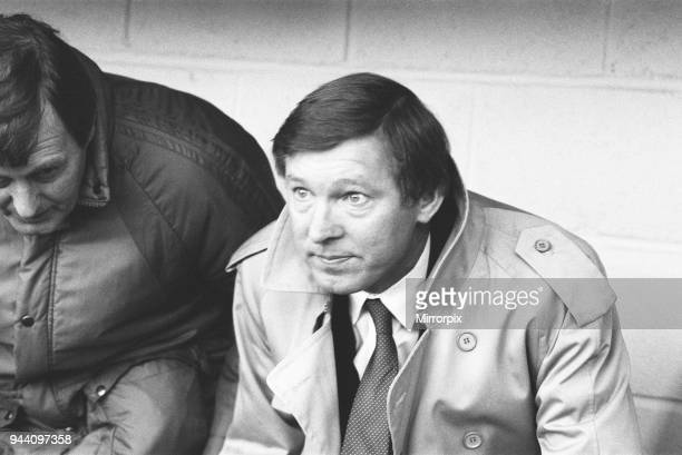 New Manchester United manager Alex Ferguson watches his team in action in the League Division One match against Oxford United a the Manor Ground his...