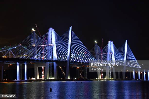 new mario m cuomo bridge in tarrytown ny lit up - westchester county stock pictures, royalty-free photos & images