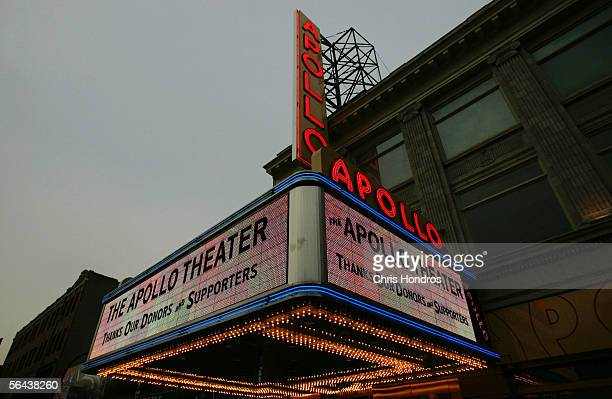 A new marquee and vertical sign for Harlem's Apollo Theater is illuminated for the first time December 15 2005 in New York City The landmark theater...