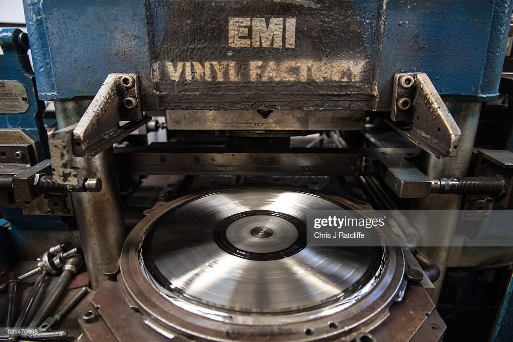 A new master record of 'Definitely Maybe' by Oasis is inserted into a machine reading for pressing copies at The Vinyl Factory on January 11, 2017 in Hayes, England. The Vinyl Factory is the largest vinyl pressing plant in the United Kingdom and produces up to 1.4 million records a year. The factory was founded in 2001 and has seen a 20% increase in sales and production year on year with clients including Warner Music, Universal Music, Bjork's label and their own label. Sales of vinyl records reached a 25 year high in 2016 when more than 3.2 million LPs were sold, a rise of 53% on the previous year.
