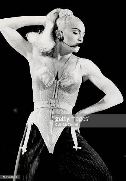 New Material With no sign of the throat virus that cancelled her Chicago concert superstar Madonna puts on a raunchy spectacle of dance and music for...